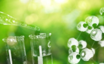 test tube and drop of water with science chemical structure on green